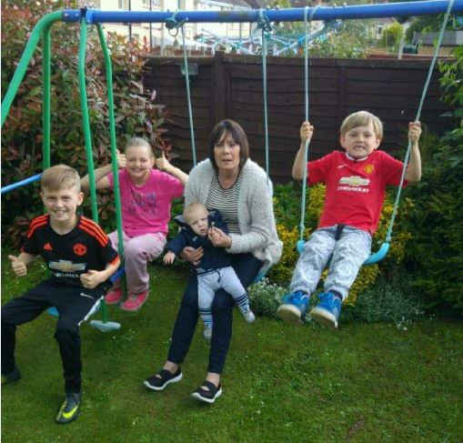 Linda with grandchildren